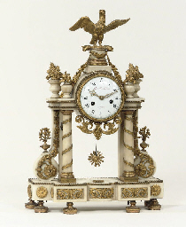 A LOUIS XVI OMROLU MOUNTED AND