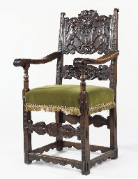 A SWISS CARVED WALNUT ARMCHAIR