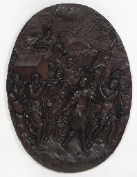 A CARVED OAK HIGH RELIEF SHIEL