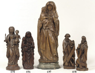 A CARVED WOOD GROUP OF ANNA SE