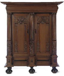 A DUTCH OAK AND EBONY CUPBOARD