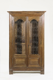 A FRENCH PROVINCIAL OAK BOOKCA