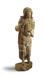 A WOOD GUARDAN FIGURE,