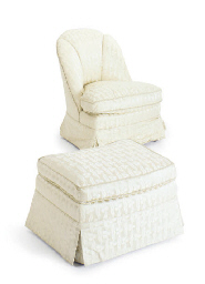 AN UPHOLSTERED SLIPPER CHAIR A