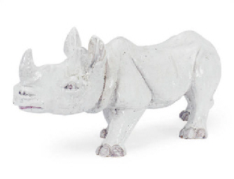 A WHITE-GLAZED CERAMIC RHINOCE