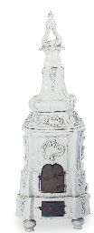 A CONTINENTAL FAIENCE STOVE,