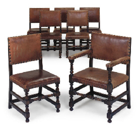 A SET OF SEVEN OAK DINING CHAI