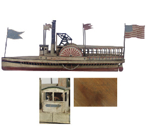 A CARVED AND PAINTED STEAMBOAT