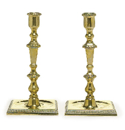 A PAIR OF BRASS CANDLESTICKS