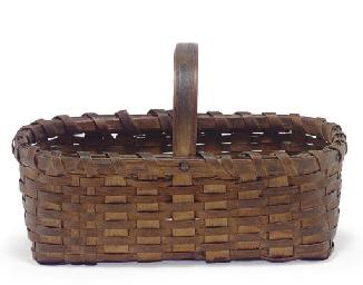 A ONE-HANDLED WICKER BASKET