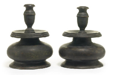 A PAIR OF TURNED WOOD CANDLEST