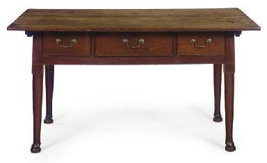 A QUEEN ANNE WALNUT TABLE