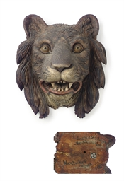 A CARVED AND PAINTED LION'S HE