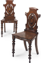 A PAIR OF MID VICTORIAN OAK HALL CHAIRS