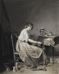 A young woman grinding coffee