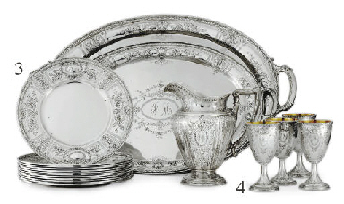 A SILVER WATER PITCHER AND TWE