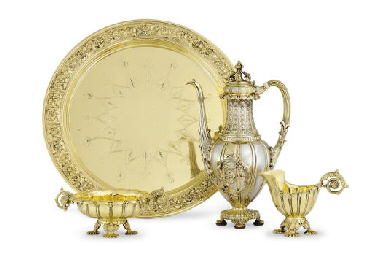 A SILVER-GILT THREE-PIECE COFF