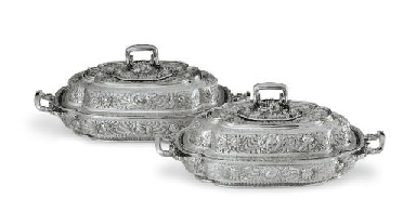 A PAIR OF SILVER COVERED TUREE