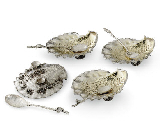A SET OF FOUR SILVER SHELL-FOR