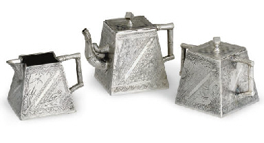 A THREE-PIECE SILVER-PLATED TEA SERVICE