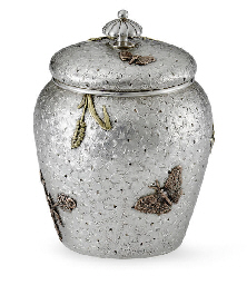 A SILVER AND MIXED-METAL TEA C