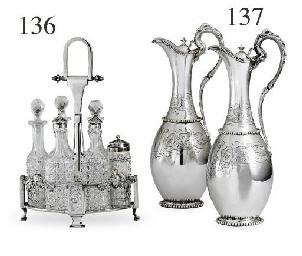 A SILVER AND CUT-GLASS CRUET S