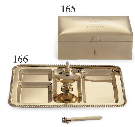 A GOLD CIGARETTE TROPHY TRAY: