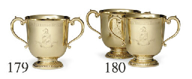 A PAIR OF GOLD TROPHY CUPS: SA