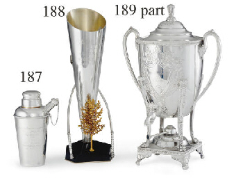 A SILVER TROPHY MARTINI SHAKER