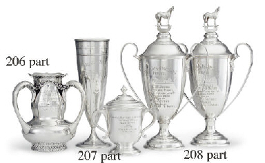 FOUR SILVER TWO-HANDLED TROPHY