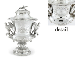 A SILVER TROPHY CUP AND COVER: