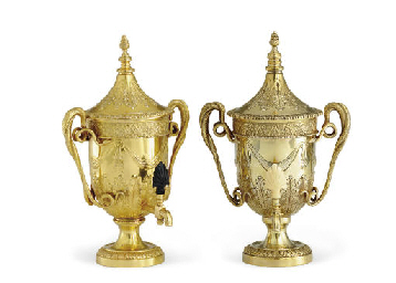 A PAIR OF SILVER-GILT HOT WATE