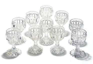 A SET OF TEN CUT-GLASS WINE GL