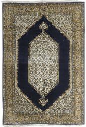 A fine silk Qum large rug