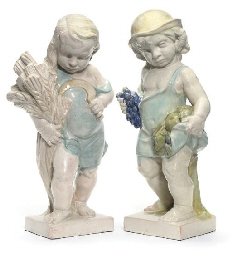 A PAIR OF GERMAN TERRACOTTA FI