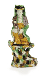 A BISCUIT-GLAZED GUANYIN ON RO