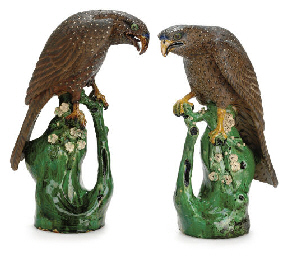 A VERY LARGE PAIR OF BROWN STONEWARE HAWKS