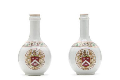 A PAIR OF BOTTLES WITH THE ARM
