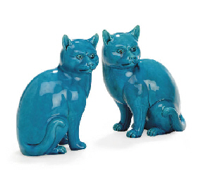 A PAIR OF TURQUOISE CATS