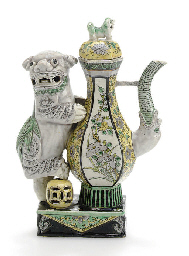 A BISCUIT-GLAZED LION EWER AND