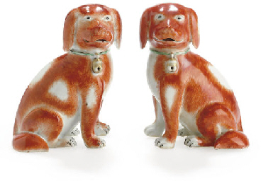 A PAIR OF SEATED SPANIELS