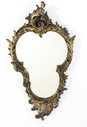 A GILT COMPOSTION WALL MIRROR