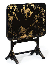 A BLACK LACQUER AND GILT TRAY