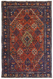 A GROUP OF FIVE PERSIAN RUGS