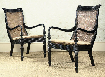 A PAIR OF SINGHALESE EBONY CAN
