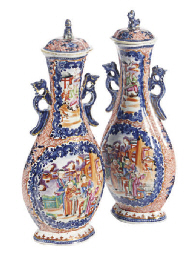 A PAIR OF CHINESE EXPORT PORCELAIN CLOBBERED MANDARIN PALETTE FLATTENED PEAR-SHAPED VASES AND COVERS,