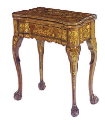 A DUTCH WALNUT AND MARQUETRY FOLD-OVER GAMES TABLE