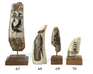 A scrimshaw whale's tooth depi