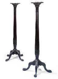 A PAIR OF VICTORIAN MAHOGANY TORCHERES