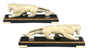 A PAIR OF INDIAN IVORY LIONS
